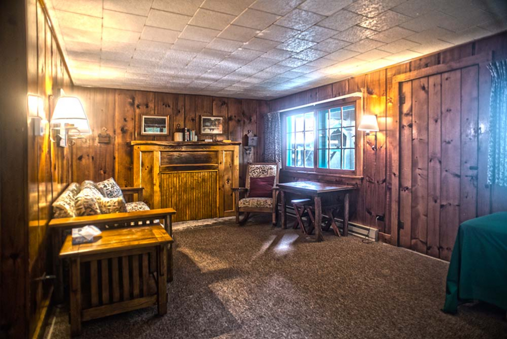 cabin with wood panel walls