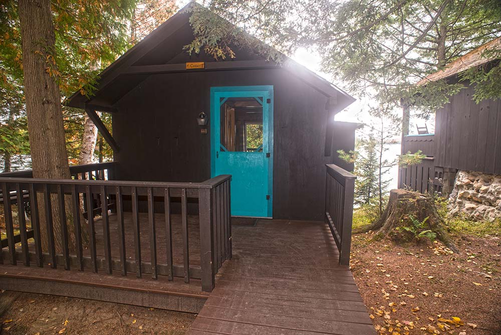 small cabin with porch