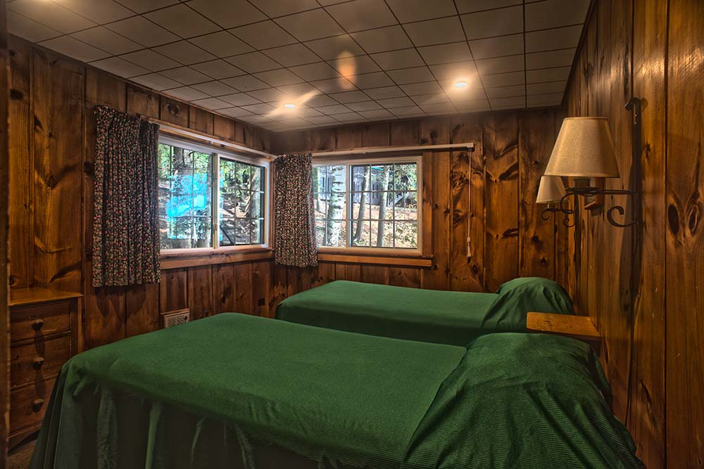 green bedspreads on beds in bedroom