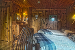 2 beds in wood paneled room
