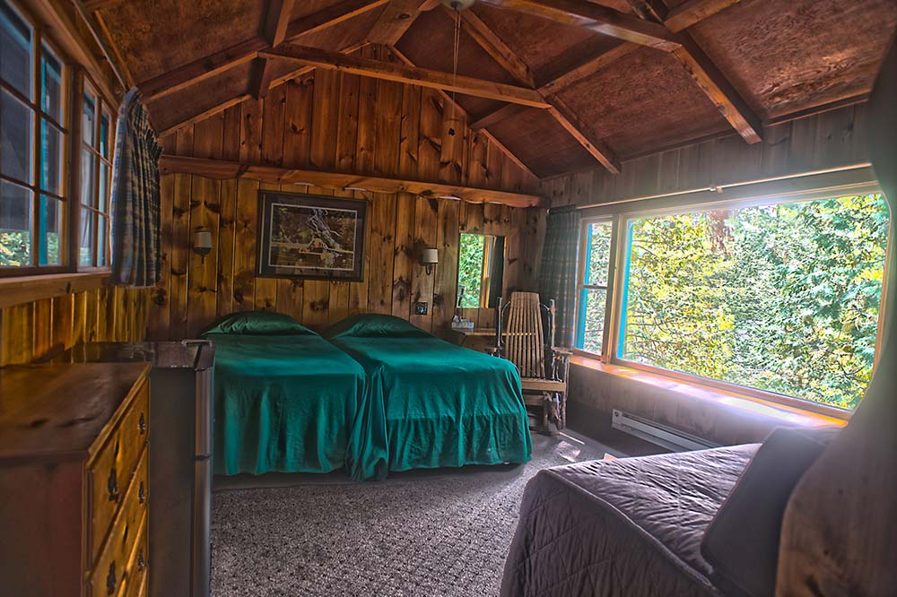 room with large window and 3 beds