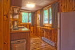 small kitchen with wood paneling