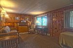 Wood paneled room with couch