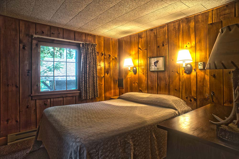 Adirondack style bedroom with queen bed